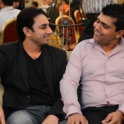 Saeed Ajmal and Kamran Akmal in a program organized by local cricket team