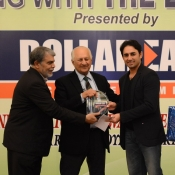 Saeed Ajmal receives a medal from Chairman PCB Mr. Shaharyar M. Khan in a program organized by local cricket team