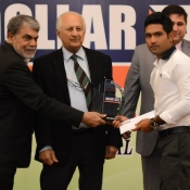 Asad Shafiq receives a medal from Chairman PCB Mr. Shaharyar M. Khan in a program organized by local cricket team