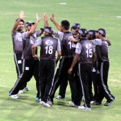 Sialkot Stallions players celebrate the wicket