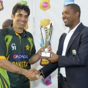 Misbah-ul-Haq receives trophy after winning the ODI series against West Indies