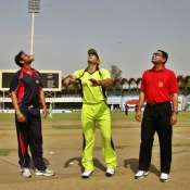 Misbah-ul-Haq and Shoaib Malik during toss in 2nd One Day practice match at Gaddafi Stadium Lahore
