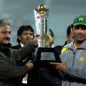 Misbah-ul-Haq receives the trophy after winning ODI series 2-1 against India