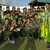 Pakistan team celebrates with the trophy after winning the T20 series against West Indies