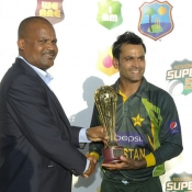 Mohammad Hafeez receives the trophy after winning the T20 series against West Indies