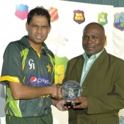 Zulfiqar Babar receives Man of the Series trophy against West Indies in T20 series
