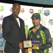 Umar Akmal receives Man of the Match award in 2nd T20 against West Indies