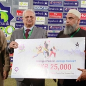 Ahmed Shehzad of Lahore Loins receiveing man of the match award against Sialkot Stallions
