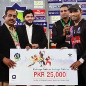 Asif Ali of Faisalabad Wolves receiving man of the match award against Tigers in 2nd Semi Final