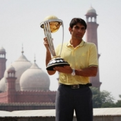 The Team Pakistan captain poses with the ICC CWC 2015 Trophy with historic Badshahi Mosque in the backdrop, 17 Sep 2014, Lahore