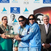 Chairman PCB presenting the benazir bhutto trophy to ZTBL captain Sana Mir