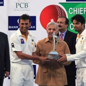 Chief Minister Punjab Mian Muhammad Shahbaz Sharif giving away trophy to both captains.