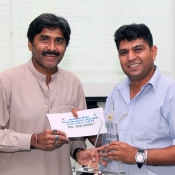 Director General PCB Javed Miandad presents Aleem Dar Trophy to Ahsan Raza for Best umpire of the year