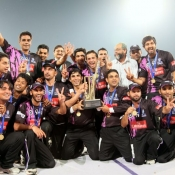Faisalabad wolves winner of Faysal Bank Super Eight T20 tournament posing with the trophy