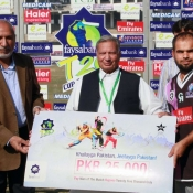 Farrukh Shehzad of Faisalabad Wolves receiveing man of the match award against Bahawalpur Stags