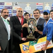 ZTBL captain Imran Nazir receives winning trophy from PCB Chairman