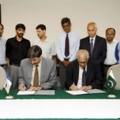 Shaharyar M. Khan Chairman PCB and Dr Sohail Naqvi Vice-Chancellor of LUMS signed an MOU