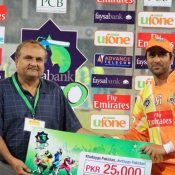 Lahore Lions Adnan Rasool receives Man of the Match award in Faysal Bank Super Eight T20 match against Falcons