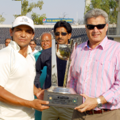 Port Qasim Authority captain Khalid Latif receives winning Trophy from Zakir Khan Director Cricket Operations (Domestic).