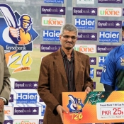 Sharjeel Khan of ZTBL receives Man of the match award against SNGPL