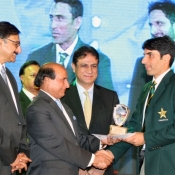 Asia cup winning captain Misbah-ul-Haq receiving his cash award & trophy from Governor Punjab Sardar Muhammad Latif Khosa. PCB Chairman Muhammad Zaka Ashraf & PTV MD Yousaf Baig Mirza are also seen in the picture