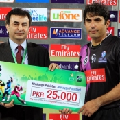 Faisalabad Wolves Misbah-ul-Haq receives Man of the Match award in Faysal Bank Super Eight T20 match against Dolphins