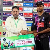 Faisalabad Wolves Ehsan Adil receives Man of the Match award in Faysal Bank Super Eight T20 Cup 1st Semi Final