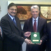 Mr. Zaka Ashraf presenting a copy of the PCB constitution to the ICC Chief Executive Mr. David Richardson in Dubai during the ICC Board meeting