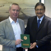 Mr. Zaka Ashraf presenting a copy of the PCB constitution to the President of the International Cricket Council (ICC) Mr Alan Isaac in Dubai during the ICC Board meeting