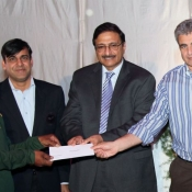 Chairman PCB Mr. Zaka Ashraf giving away the cash award to lower grade employees