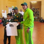 Adam Ali Shah receives a signed Sport for Life T shirt for best fielder from Pakistan cricketers Asad Shafiq and Nasir Jamshed