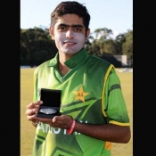 Babar Azam poses with Man of the Match award in ICC U-19 World Cup match against Scotland