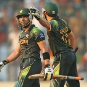 Umar Akmal of Pakistan reacts after being dismissed for 94 as Shahid Afridi congratulates him