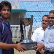 PTV Captain Imad Wasim receiving winning trophy of Patrons Trophy Grade II Tournament from D C Mirpur, AJK Mr. Ch. Guftar Hussain