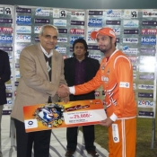 Lahore Lions Saad Nasim receives Man of the match award in Quarter Final against Multan Tigers