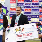 Shahzaib Hasan & Atif Maqbool of KArachi Dolphins receiving man of the match award from President Lahore Chamber of commerce Mr. Farooq Iftikhar