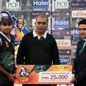 Shahzaib Hasan of PQA receives Man of the match against WAPDA
