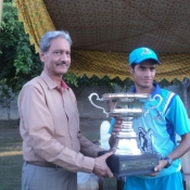 Rawalpindi Rams U-19s captain receives the winning trophy from Shafiq Ahmed Sr. GM Domestic Cricket PCB