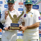 Brendan Taylor and Misbah-ul-Haq share the trophy after Test series was drawn 1-1