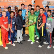 Captains of 16 teams pose with the trophy ahead of the ICC U19 Cricket World Cup 2012