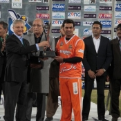Lahore Lions captain Mohammad Hafeez lifts the Faysal Bank T20 Cup 2013-14