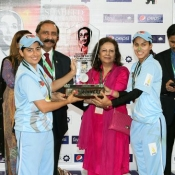 ZTBL Women team Captain Sana Mir receiving the winning trophy