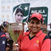 Lahore Under-21s Women captain Hafsa Amjad poses with the winning troph